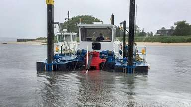 Dredging operations in June in East Creek, Town