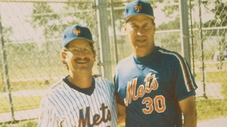 David Levine, left, with New York Mets pitching