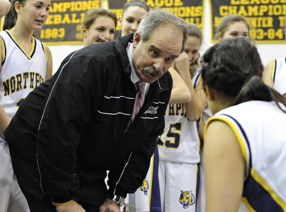 Northport's head coach Rich Castellano talks to his