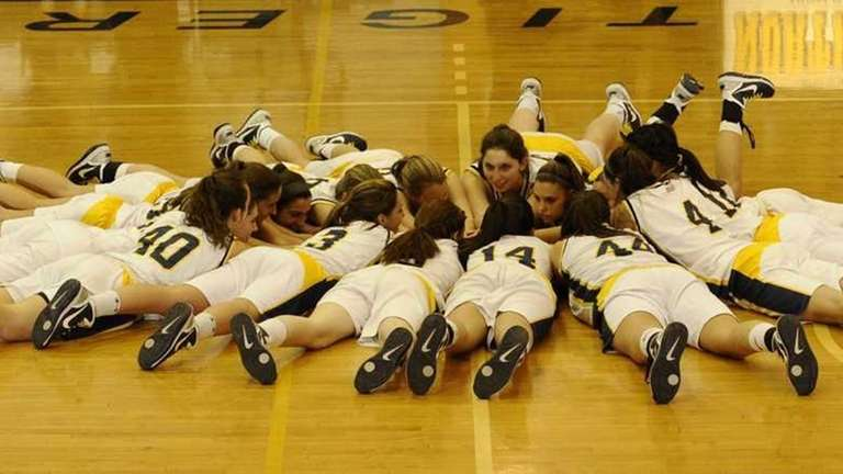 Northport's baskeball team gathers in a circle at