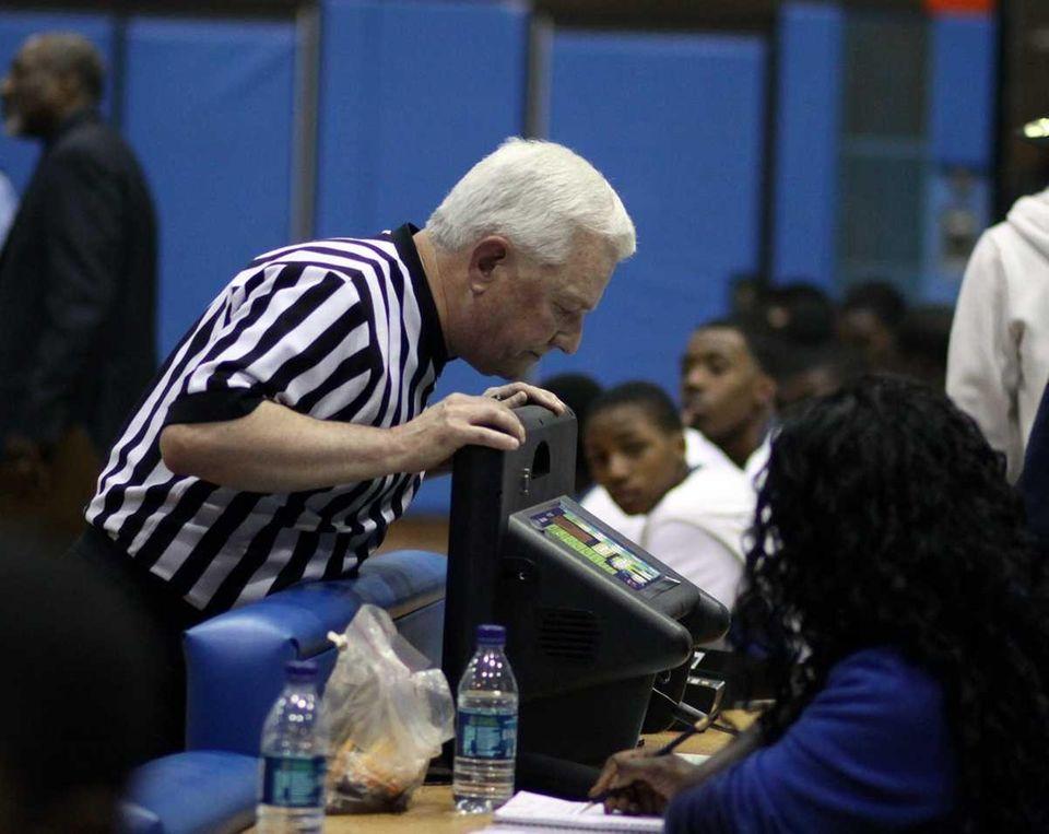 Referee checks status of scoreboard as it went