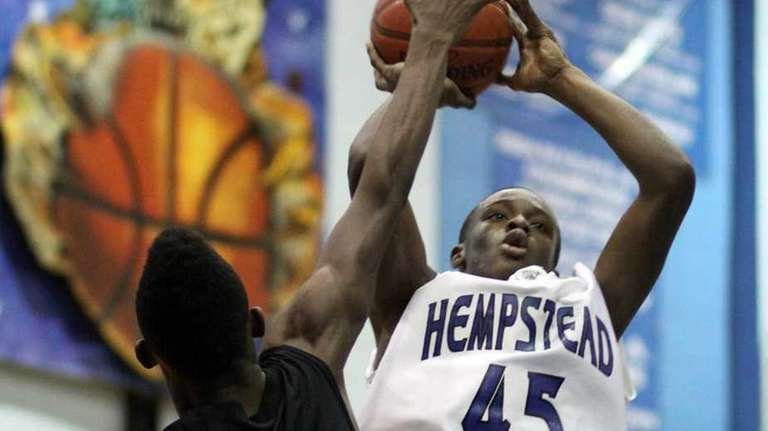 Hempstead's Michael Boyd tries for a shot over