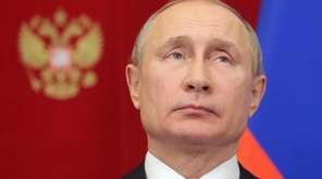 Russian President Vladimir Putin attends a ceremony Tuesday