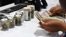 A customer pays for cannabis products.