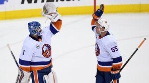 Islanders goaltender Thomas Greiss celebrates with defenseman Johnny