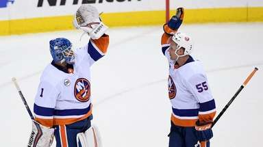 Islanders goaltender Thomas Greiss celebrates with defenseman Johnny