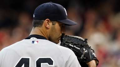 Yankees pitcher Andy Pettitte stares down the Indians'