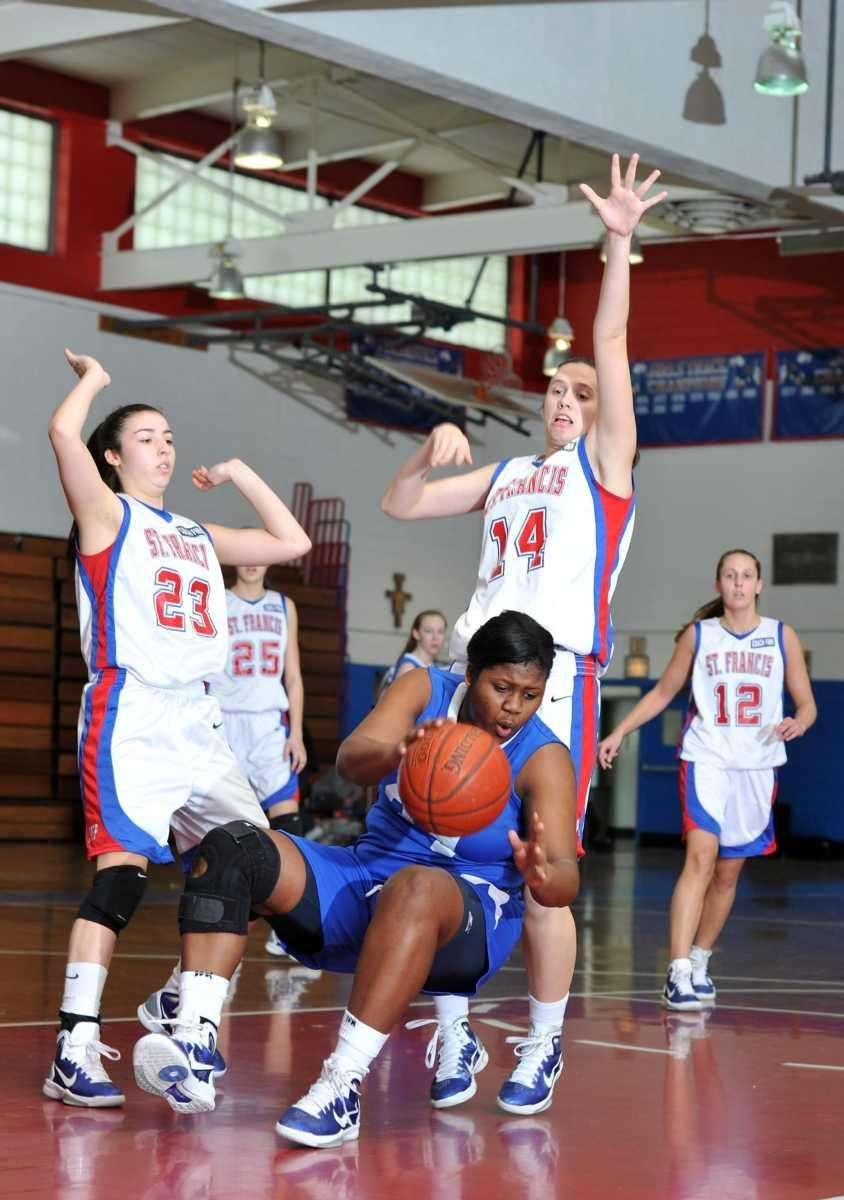 Kellenberg junior center Khadijah Donaldson (34) falls to