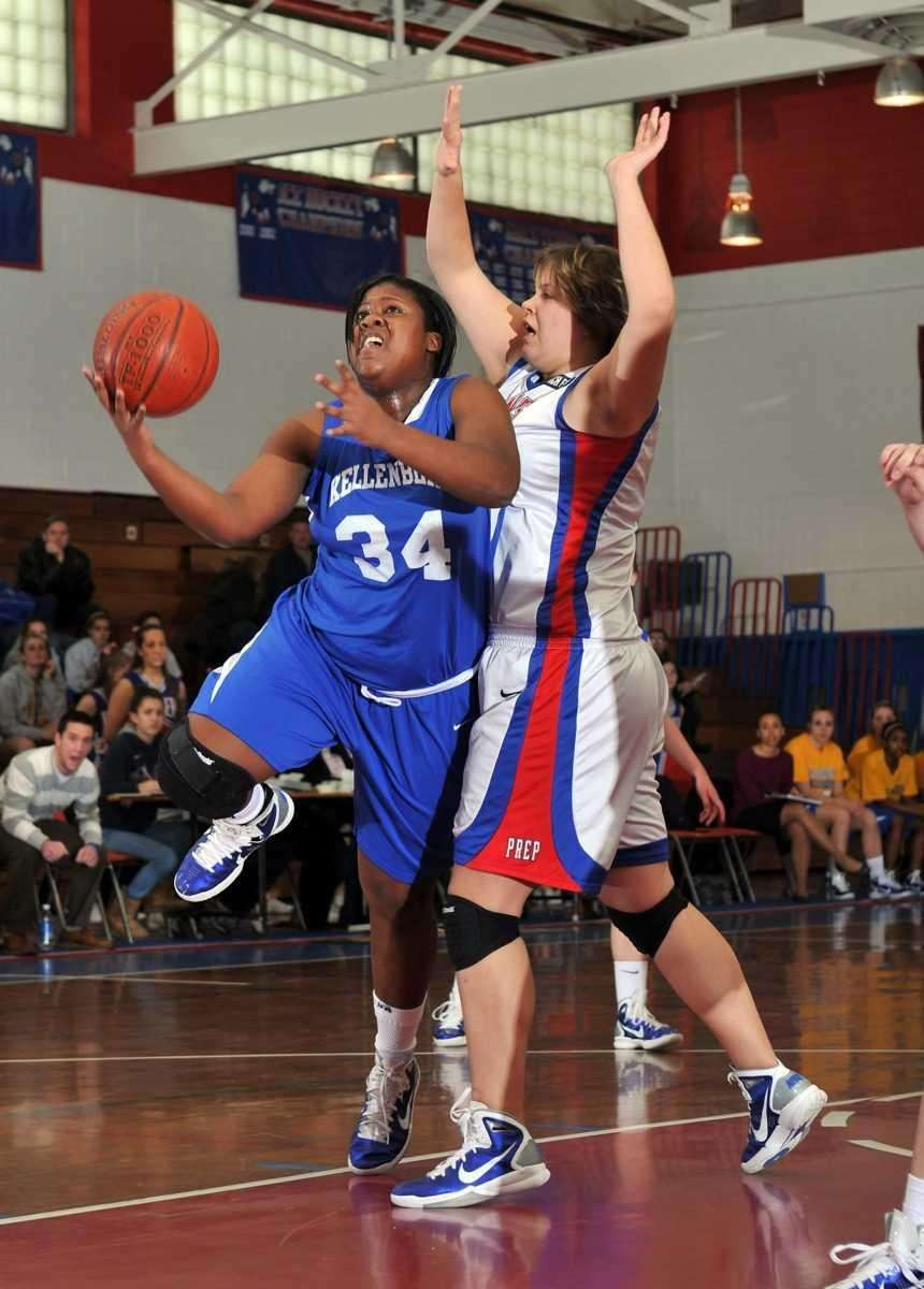 Kellenberg junior center Khadijah Donaldson (34) drives to