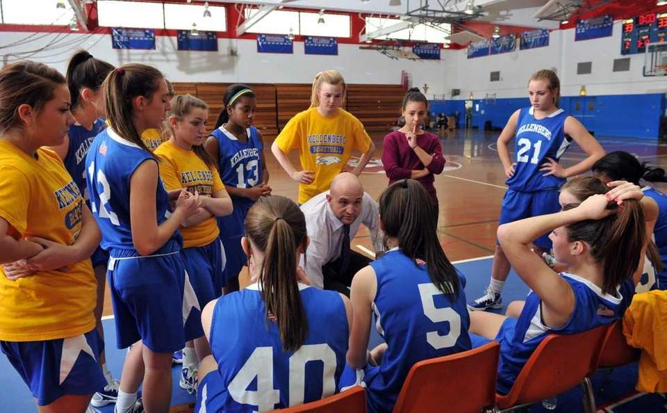 Kellenberg head coach John T. Heitner (center) talks