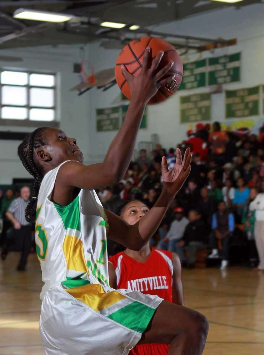 Wyandanch's Lineker St. Hilaire (15) with the layup