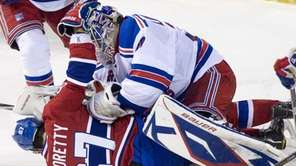 New York Rangers goaltender Henrik Lundqvist pounces on