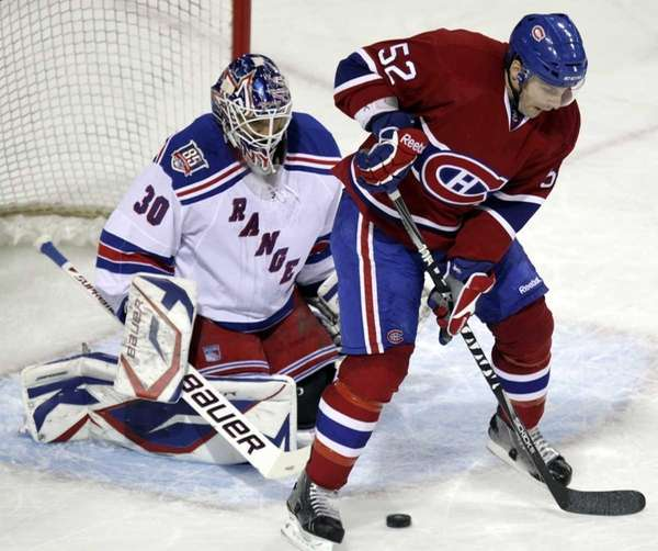 The Montreal Canadiens' Mathieu Darche blocks New York