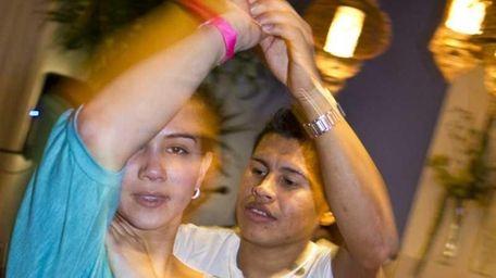 Raul Jimenez dances with Monica Pau at Monday
