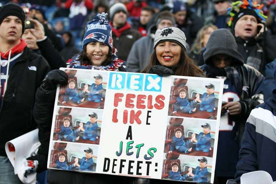 New England Patriots fans hold up a sign