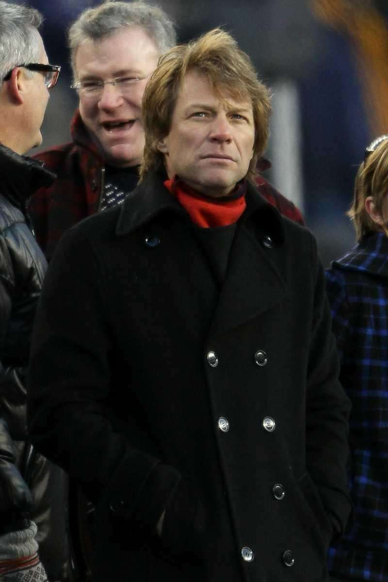 Singer-somgwriter Jon Bon Jovi watches the 2011 AFC