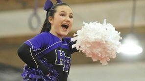 Hampton Bays varsity cheerleaders perform during a Suffolk