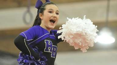 Hampton Bays varsity cheerleaders perform during a Suffolk