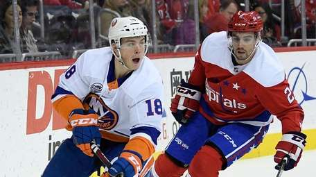 Islanders left wing Anthony Beauvillier skates with the