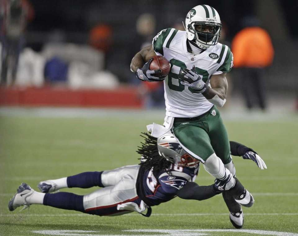 New York Jets wide receiver Jerricho Cotchery runs