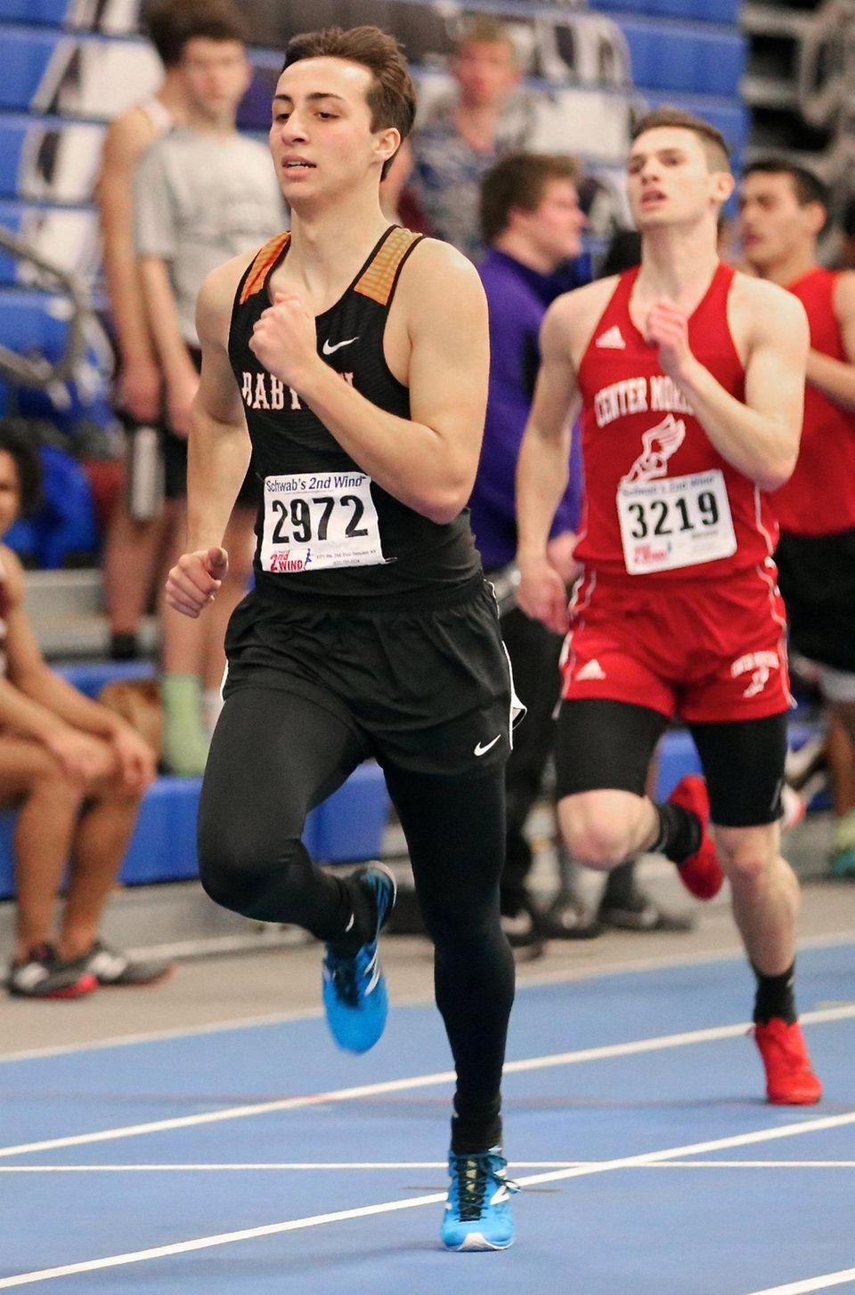 Babylon's Evan Parise wins the 300m dash in