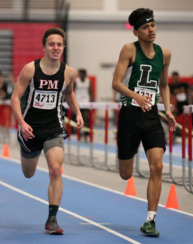 Longwood's Nicholas Scheiner , right, wins the 1000m
