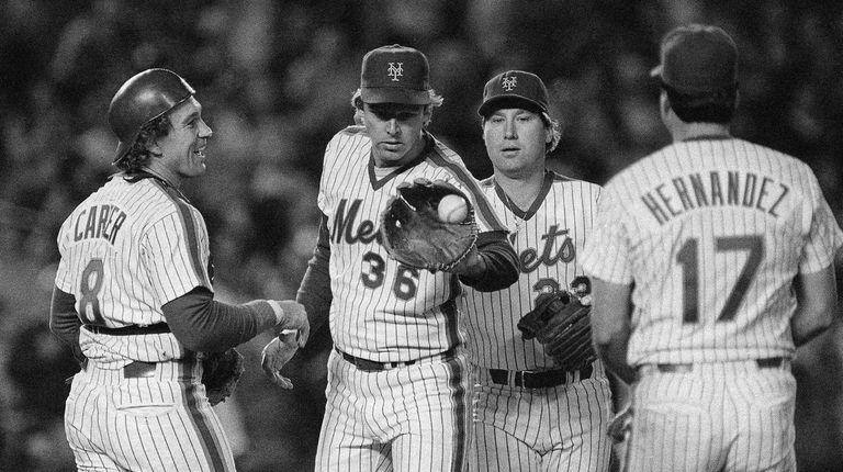 Mets catcher Gary Carter, left, congratulates pitcher Ed