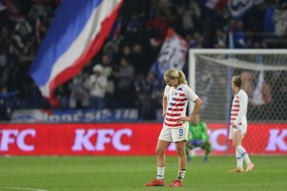 U.S. midfielder Lindsey Horan stands on the pitch