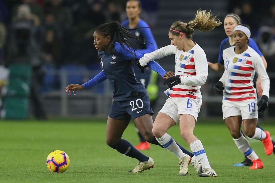 France forward Kadidiatou Diani, left, vies for the