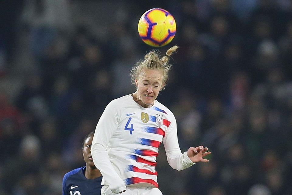 U.S. defender Becky Sauerbrunn heads the ball during