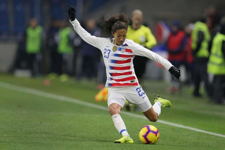 U.S. forward Christen Press shoots the ball during