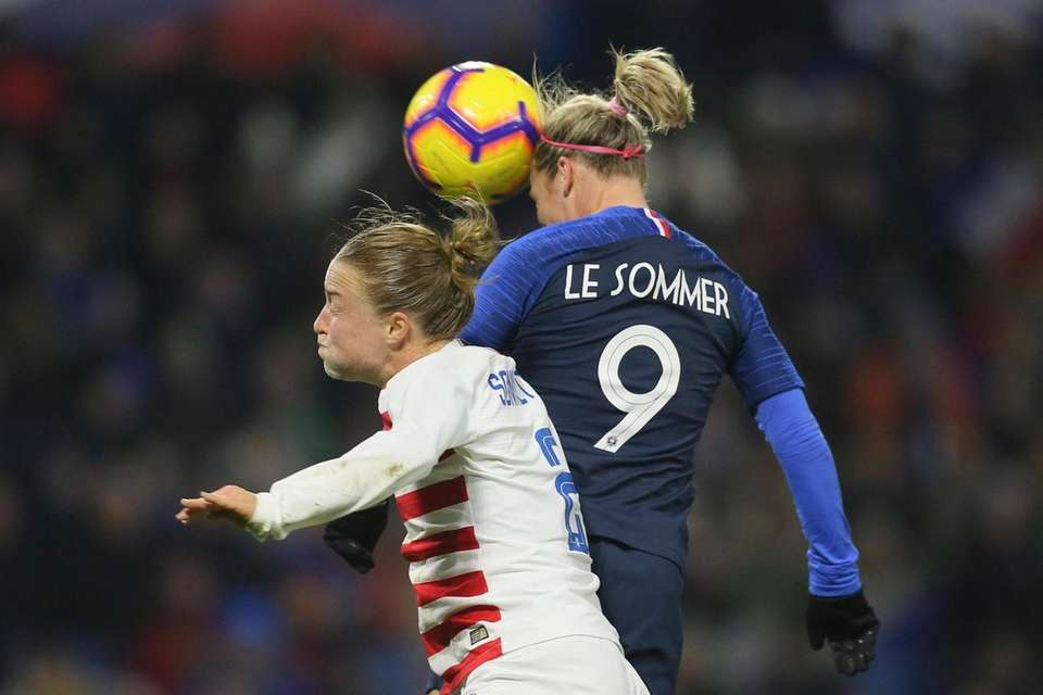 France forward Eugenie Le Sommer, top, goes for
