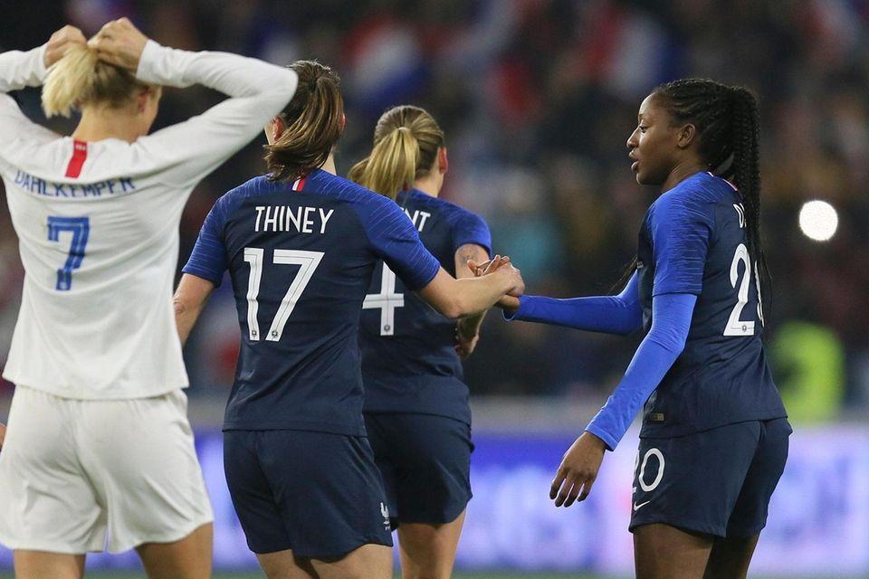 France forward Kadidiatou Diani, right, celebrates with teammate