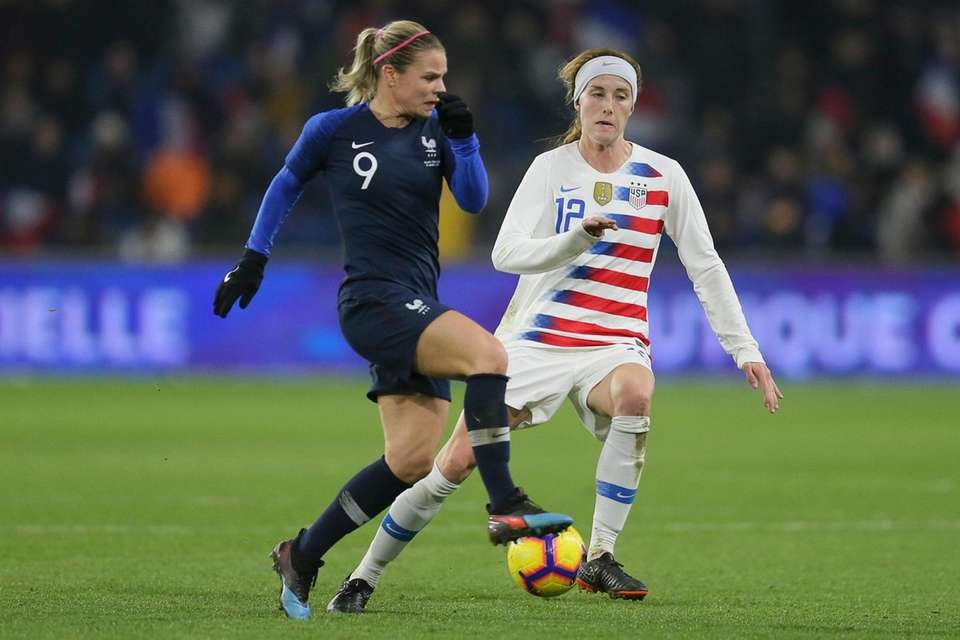 France forward Eugenie Le Sommer, left, vies for