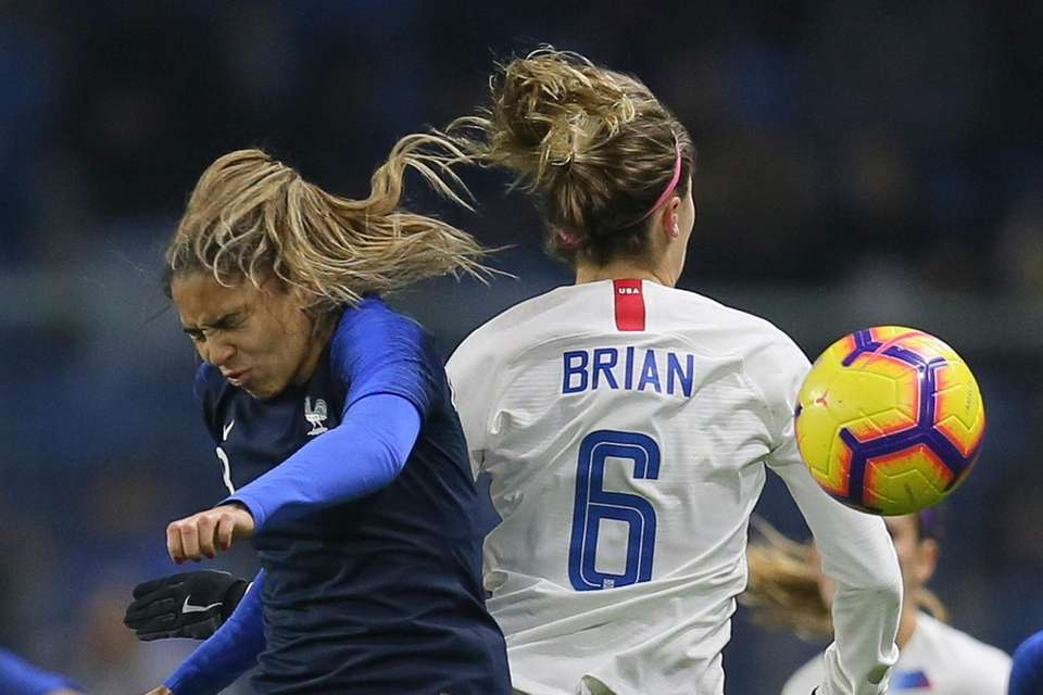 France forward Delphine Cascarino, left, vies for a