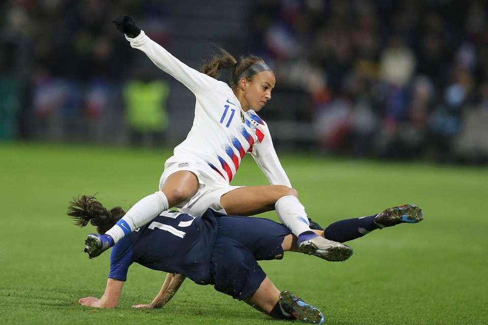 U.S. forward Mallory Pugh, top, collides with France