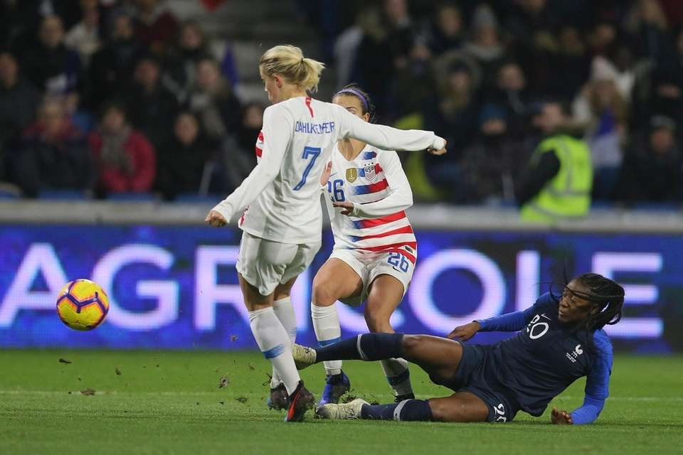France forward Kadidiatou Diani, right, battles for the