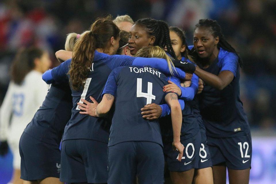 France players celebrate after teammate Kadidiatou Diani, centre,