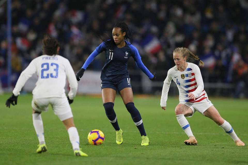 France forward Marie-Antoinette Katoto, centre, vies for the