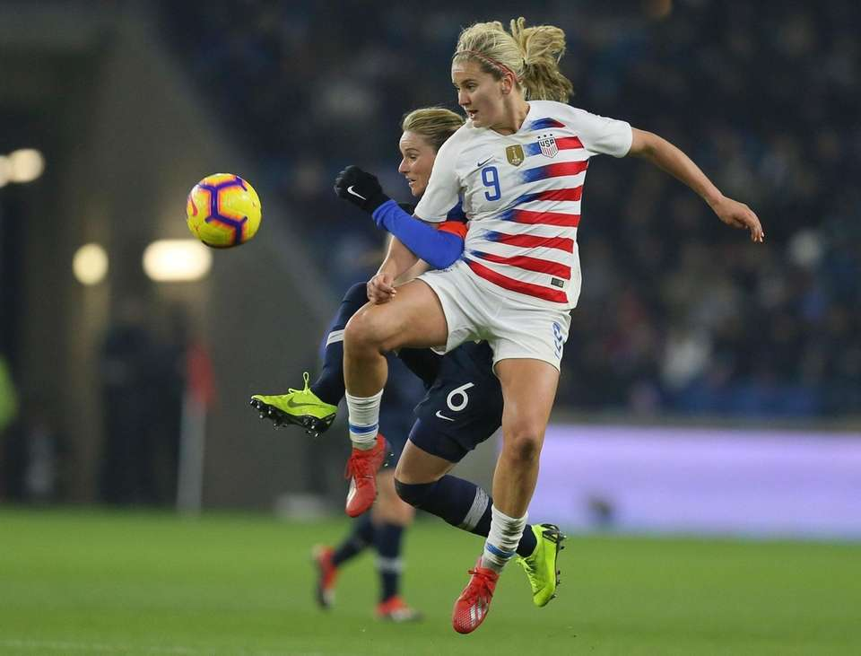 U.S. midfielder Lindsey Horan, right, vies for the
