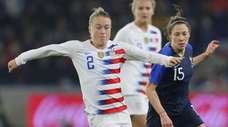 U.S. defender Emily Sonnett, left, runs with the
