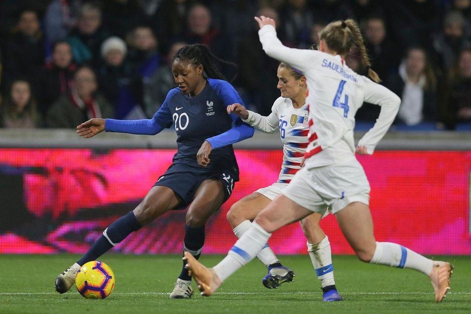 France forward Kadidiatou Diani, left, vies for the