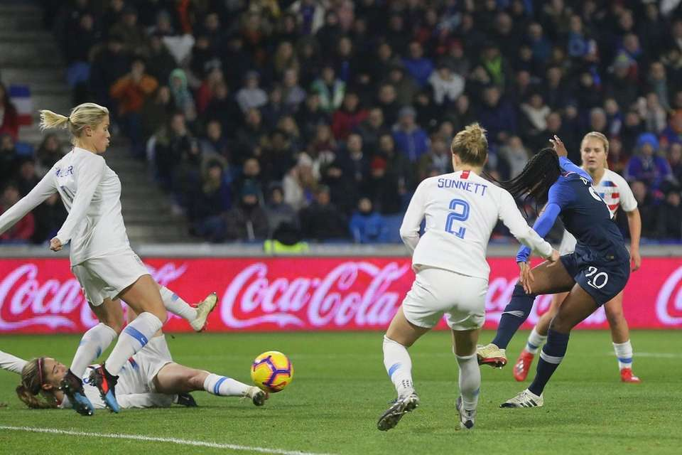France forward Kadidiatou Diani, right, shoots the ball