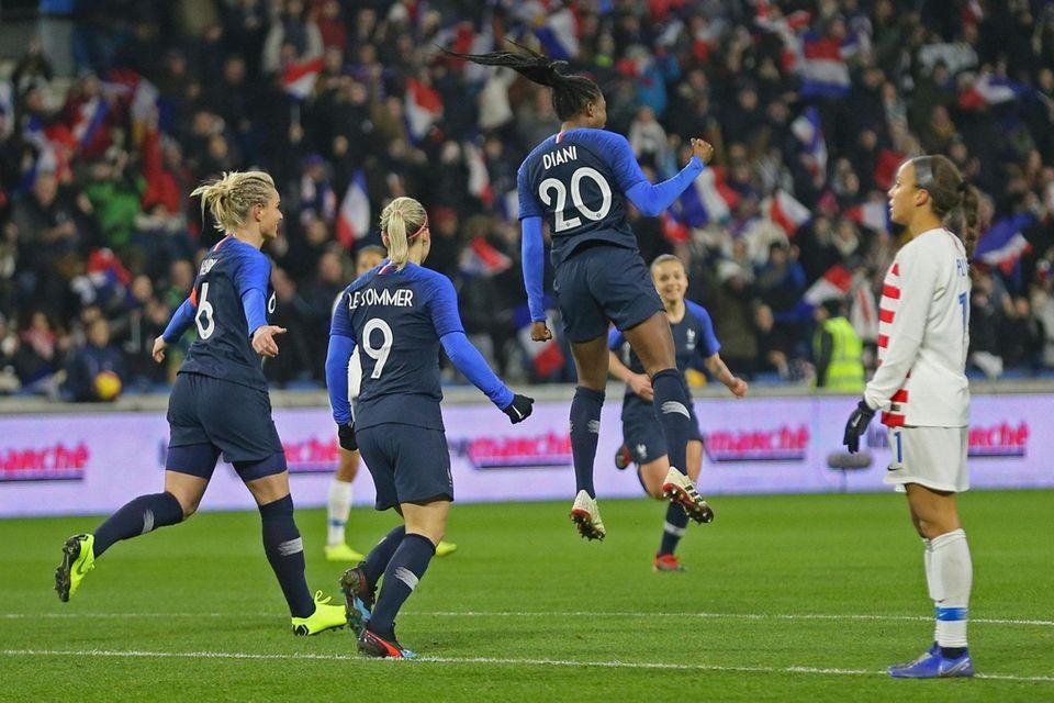 France forward Kadidiatou Diani, top, celebrates after scoring