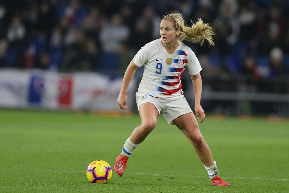 U.S. midfielder Lindsey Horan runs with the ball