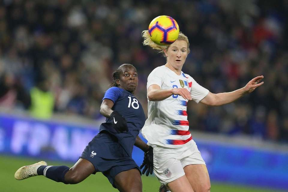 France forward Viviane Asseyi, left, vies for the
