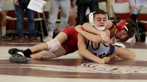 Jacob Conniker of Sachem East (red) wrestles Nick
