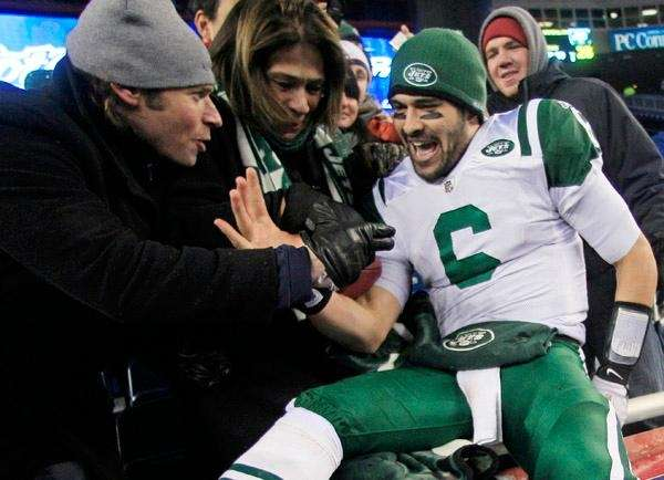Mark Sanchez celebrates the Jets' win with fans.