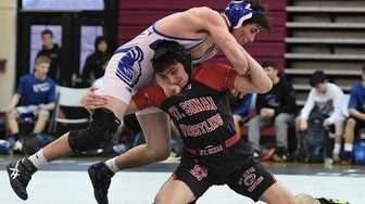 Mt. Sinai's Joseph Goodrich, bottom, wrestles John Glenn's
