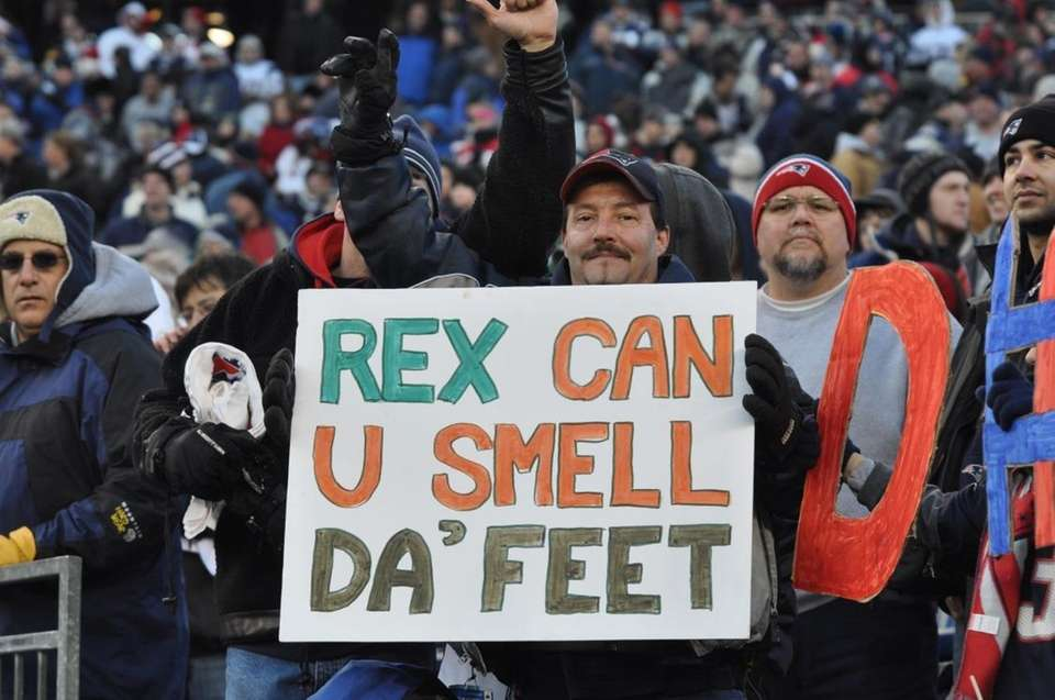 Patriots hold up a sign directed toward Jets